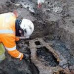Nearly 10,000 skeletons were discovered in mass graves beneath a UK city